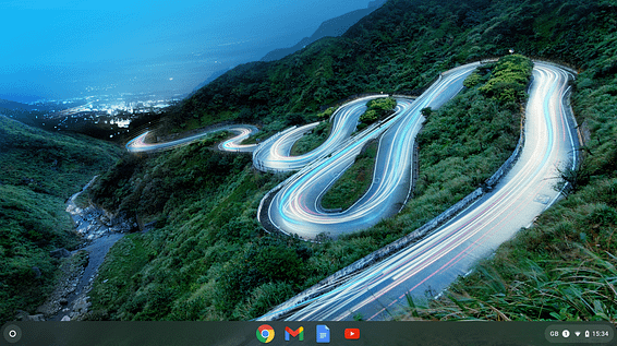 Chromebook desktop view of a hillside with a meandering road