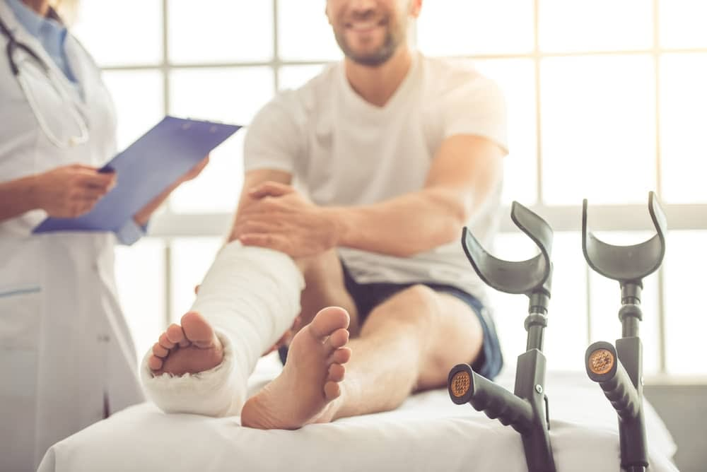 Man with fractured leg being treated