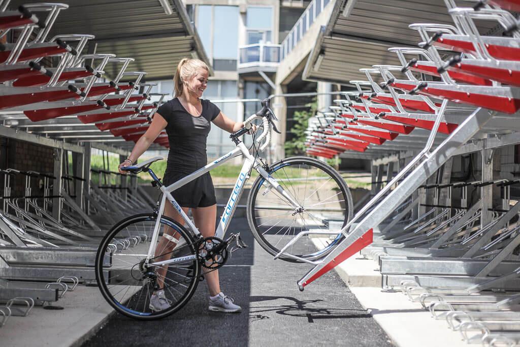 Parking Bike into two-tier Storage Rack