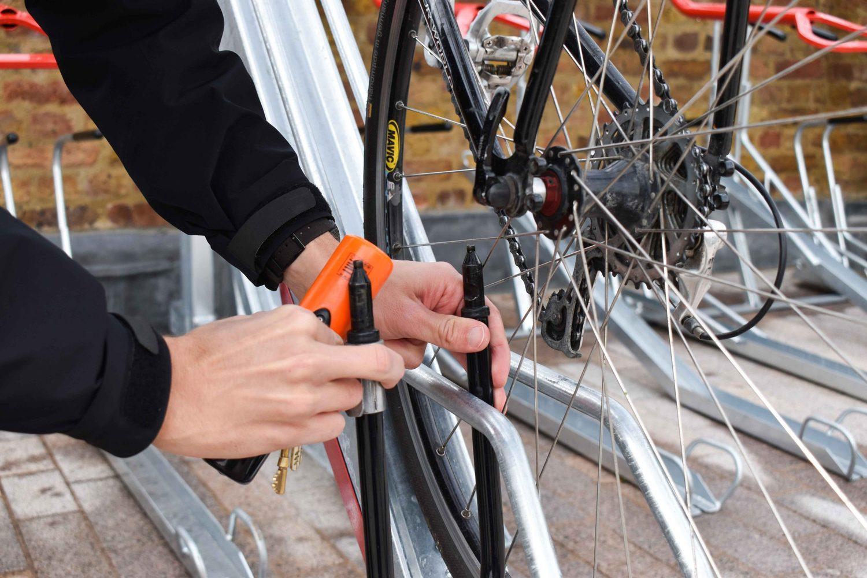 Two tier bike racks with man locking their bike