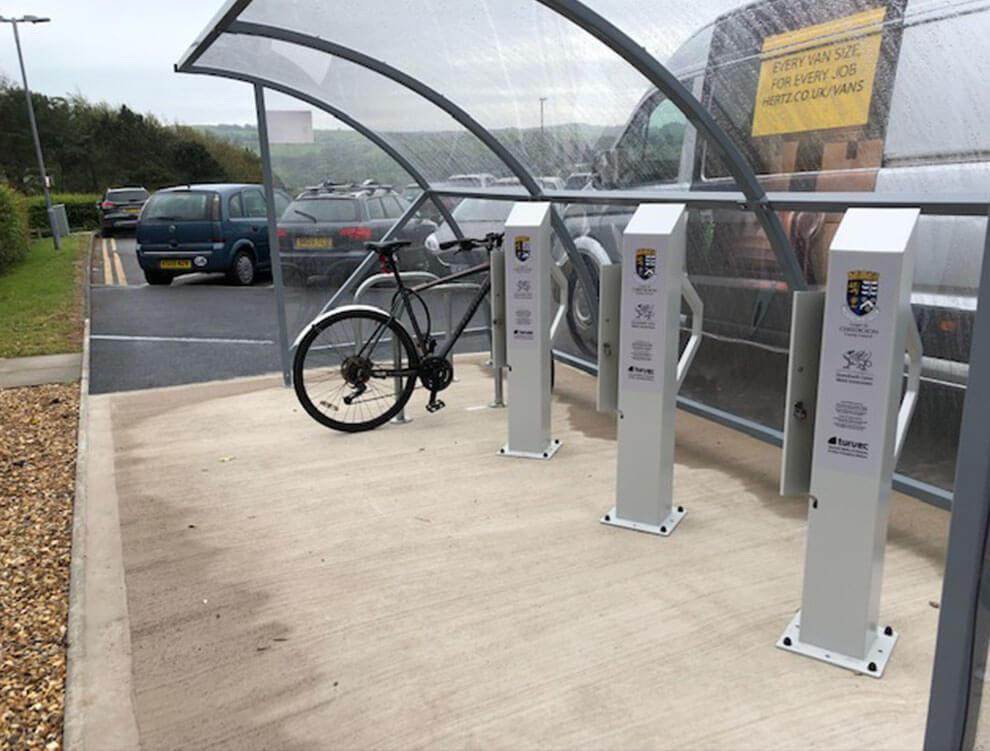 Glass curved bike shelter with electric stations
