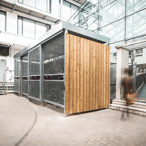 Wood and mesh bike shelter