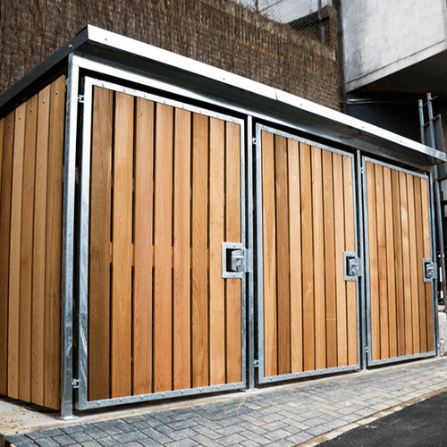 Wooden bike shelter with locking doors in brown
